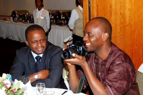 Mulenga Sata (Right in the picture holding a camera)